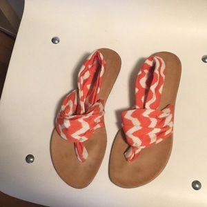 Orange and white fabric sandals